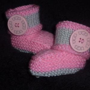 BABY BOOTIES WITH LARGE WOODEN BUTT..